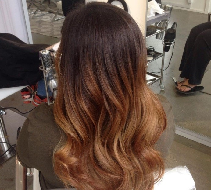 woman with tiger eye chestnut brown hair colour at a salon
