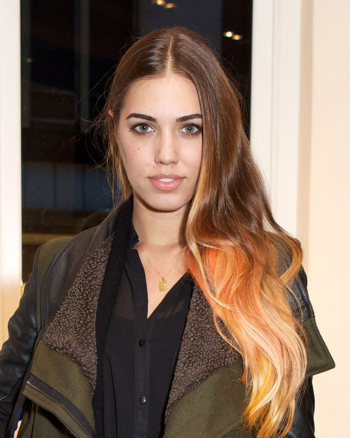 amber le bon with peach light brown ombre hair on the red carpet smiling