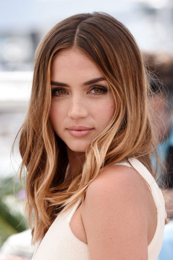 shot of ana de armas with sun kissed light brown ombre hairstyle on the red carpet