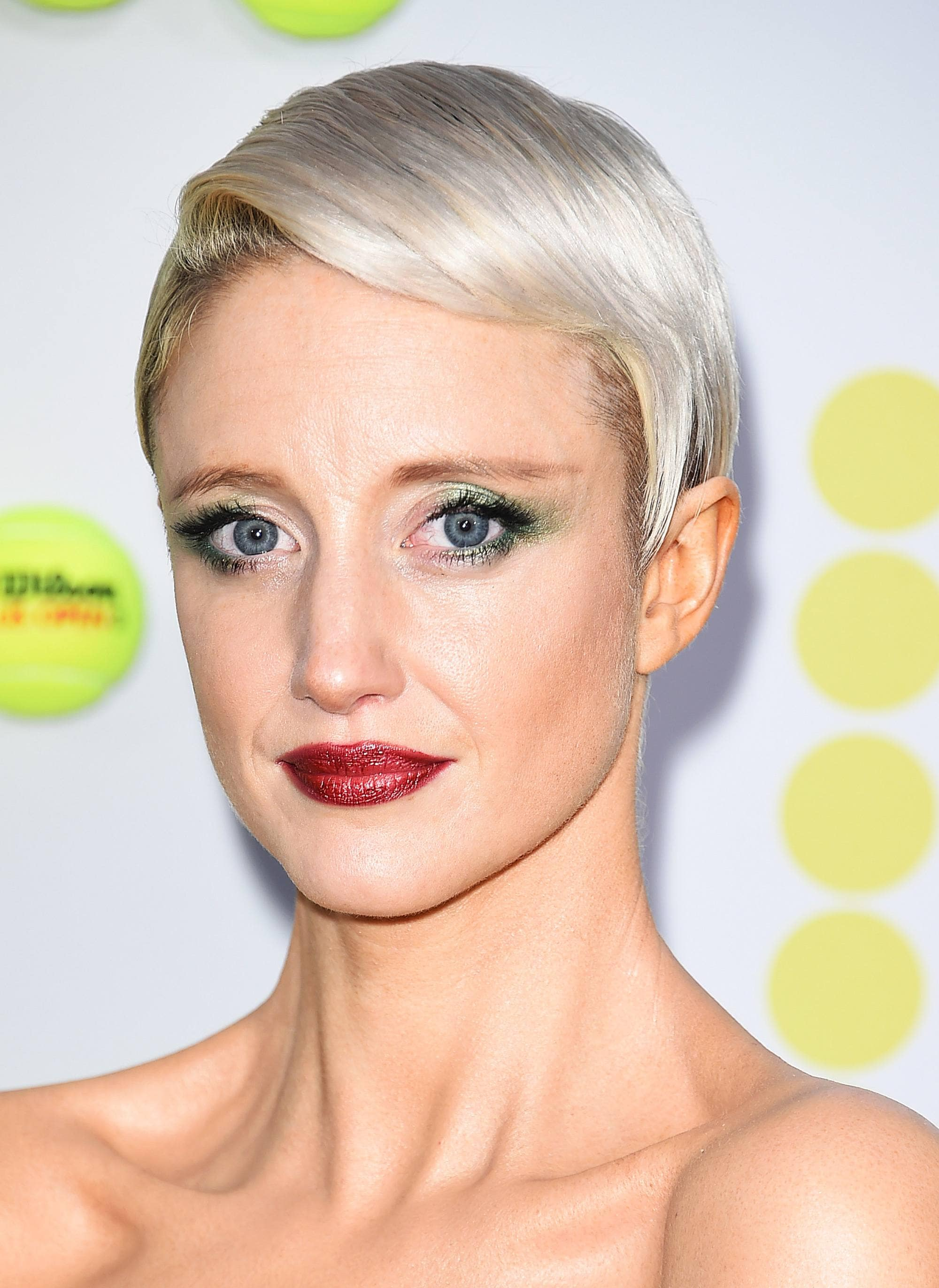 Andrea Risebourough with silver blonde sleek pixie hairstyle on the red carpet