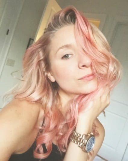 selfie of a blonde woman with peach balayage highlights