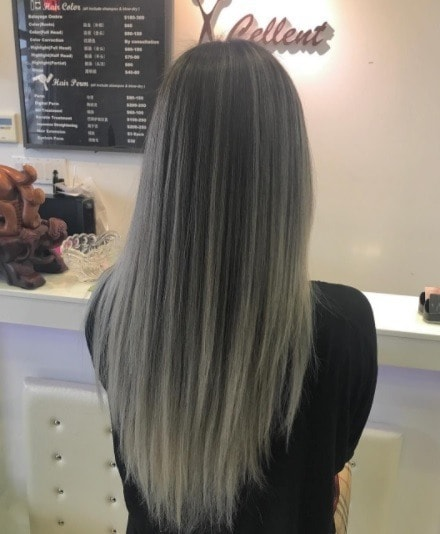 back shot of a woman with long straight charcoal ombre hair