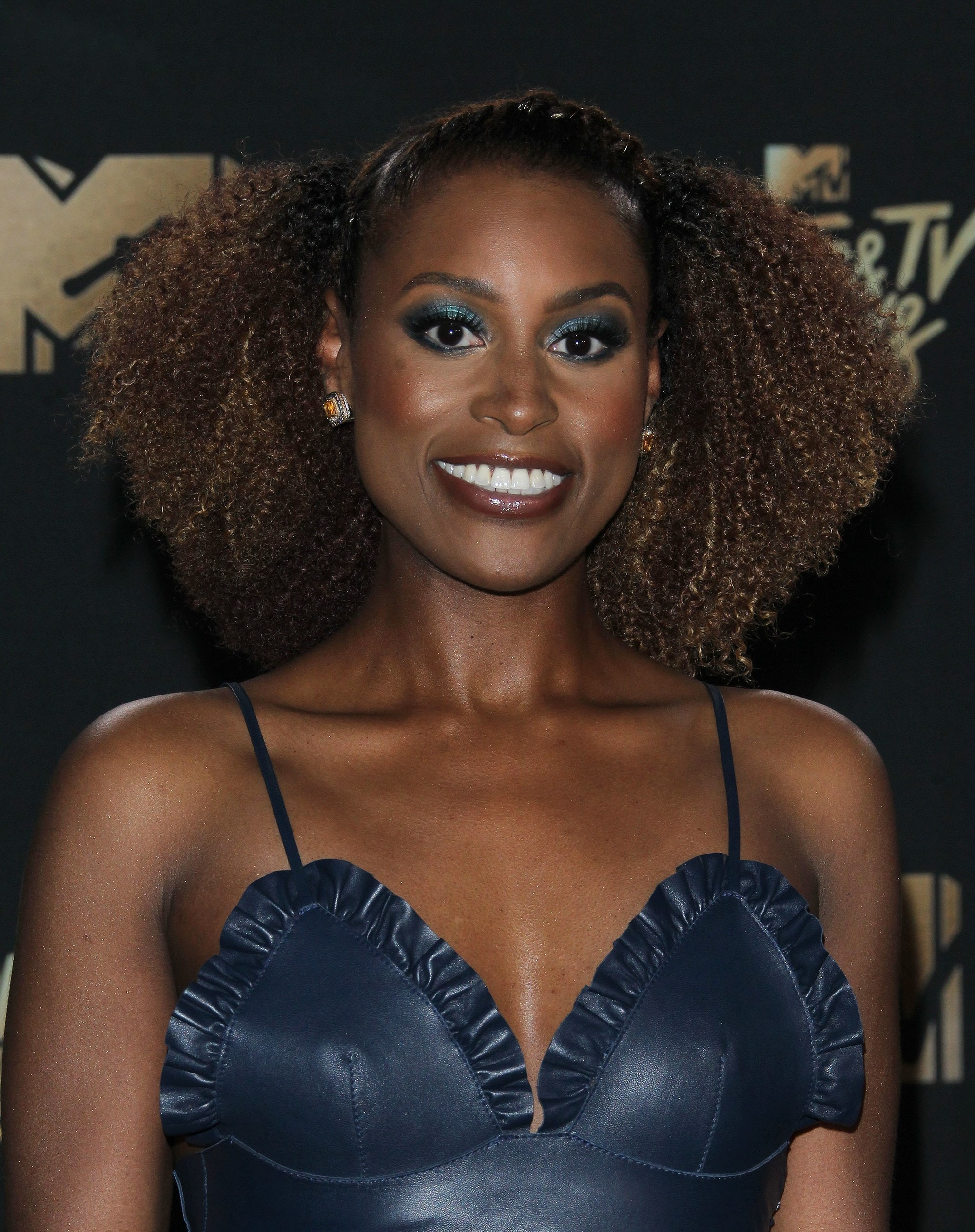 dark brown hair with ombre: issa rae with chocolate brown ombre curly hairstyle on red carpet
