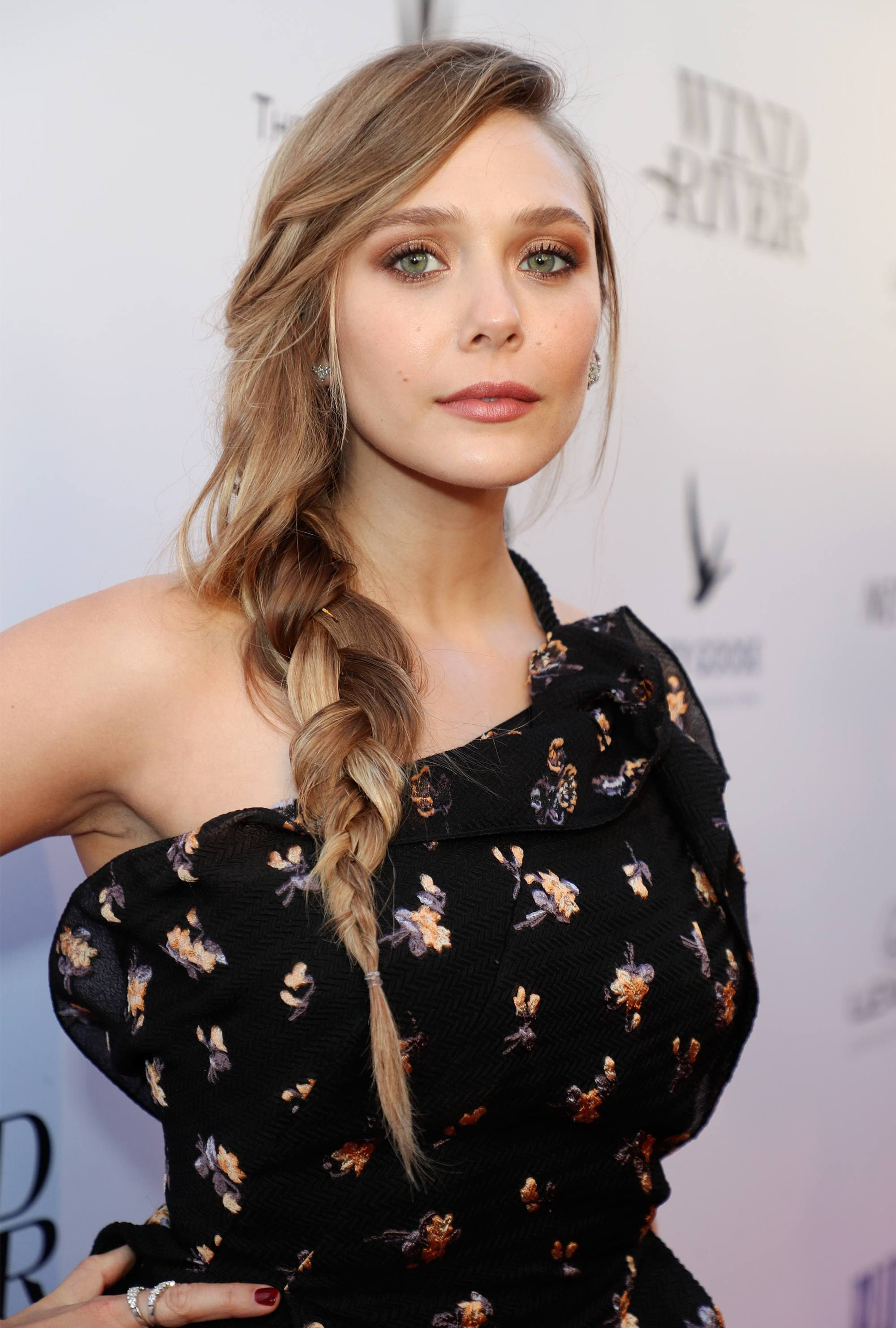 Elizabeth Olsen with loose long side braid hairstyle