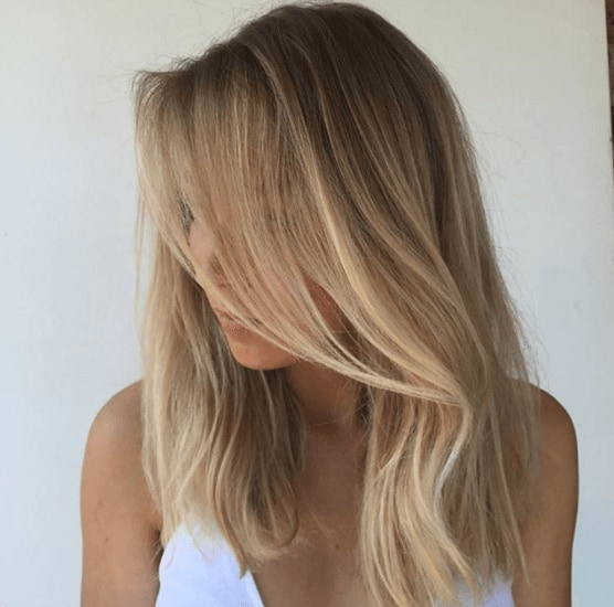 mid length to long brown hair with blonde highlights framing the face