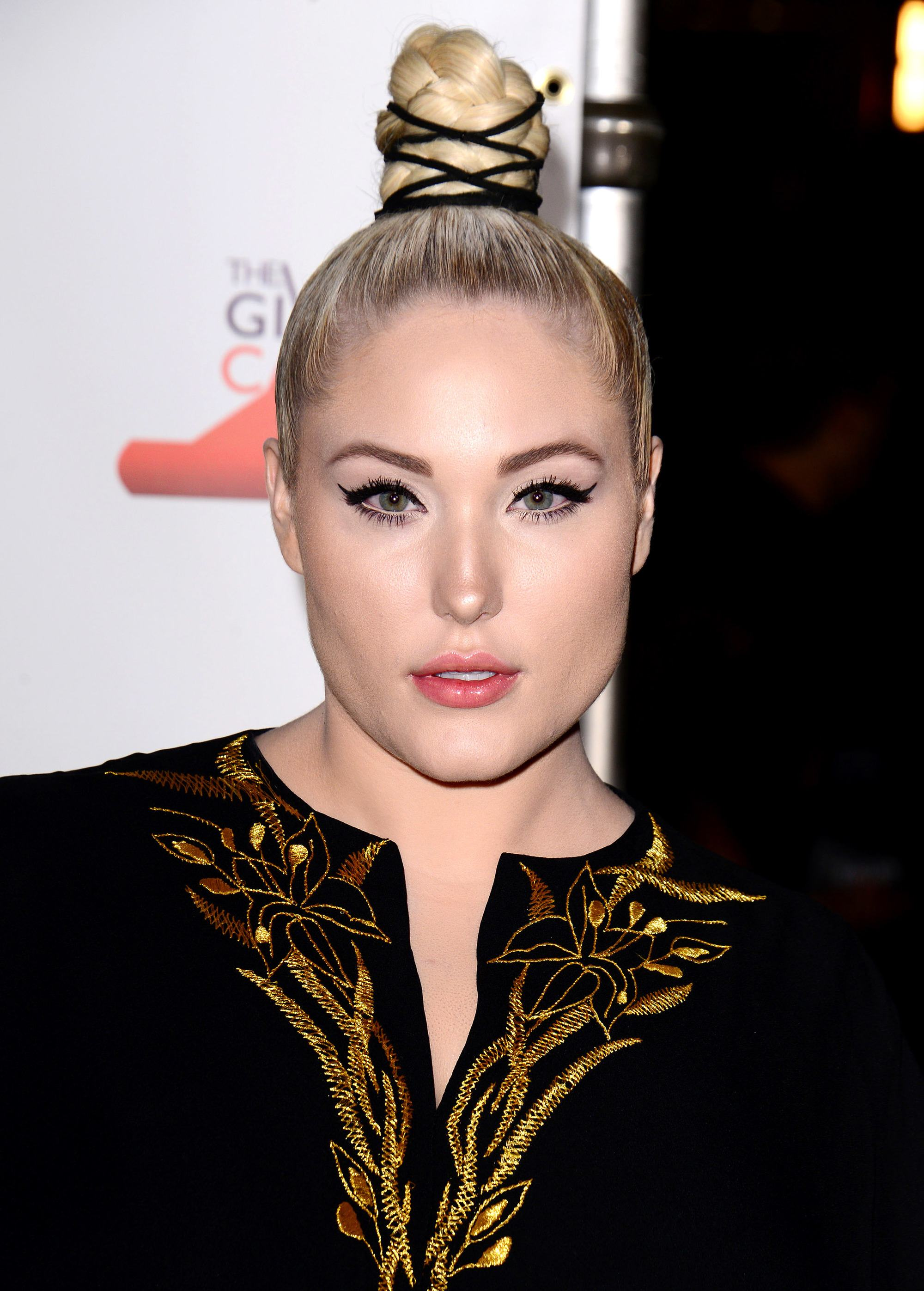 close up shot of Hayley Hasselhoff with braided top knot hairstyle