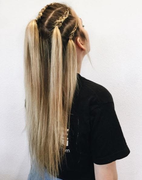 Long medium toned blonde straight hair with front section braided back shown from side view