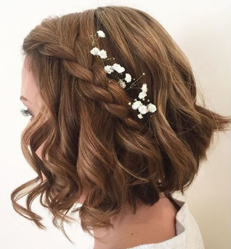 side veiw of brown wavy long bob with side braid and floral acessories