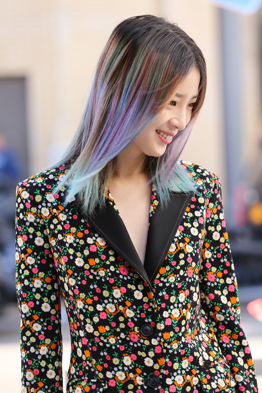 side shot of irene kim with rain dark brown ombre hair