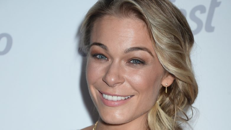 country singer leann rimes with her long blonde hair in a side braid