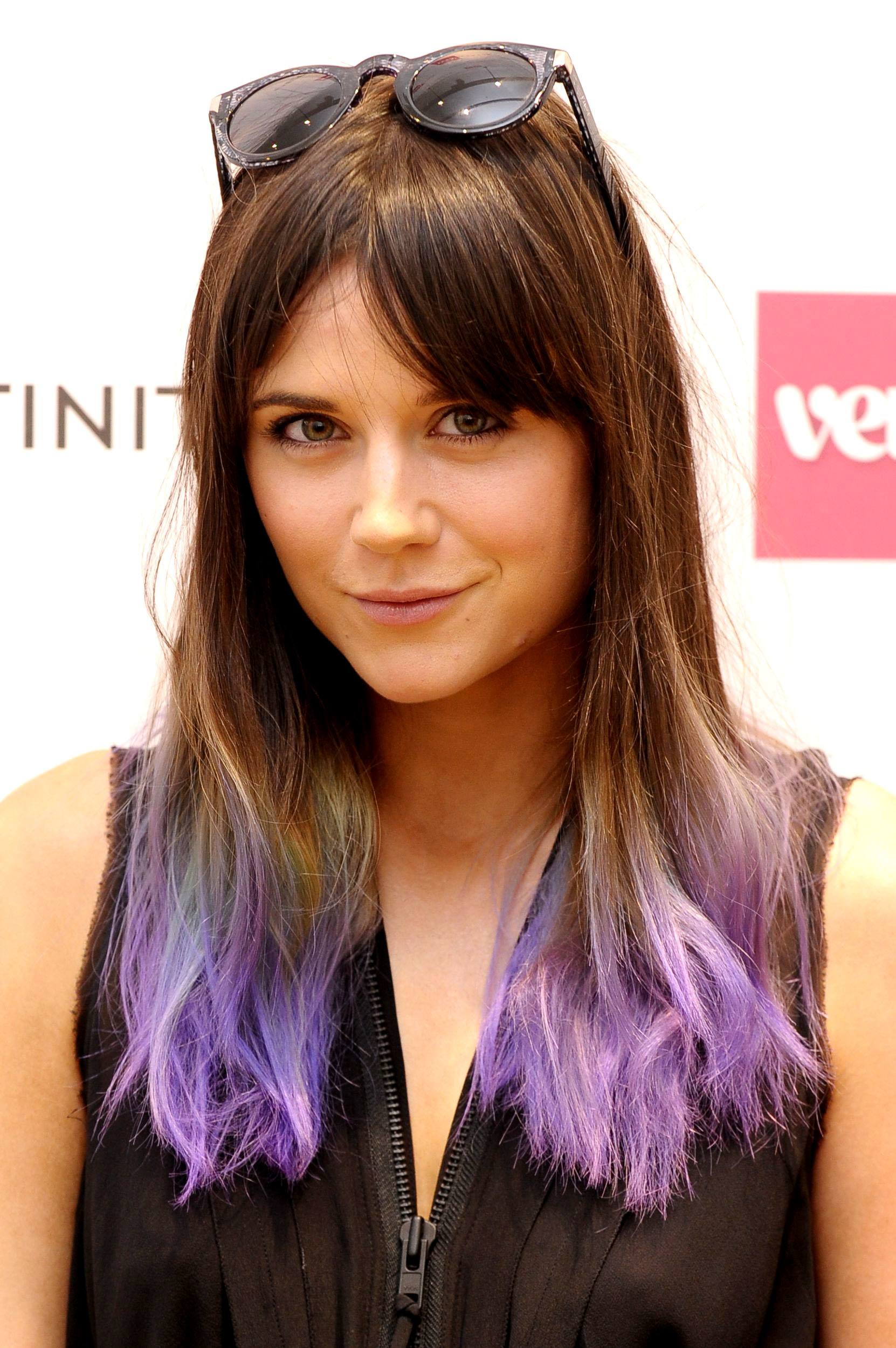 Lilah Parsons with dark brown hair that has ombre tips on the red carpet