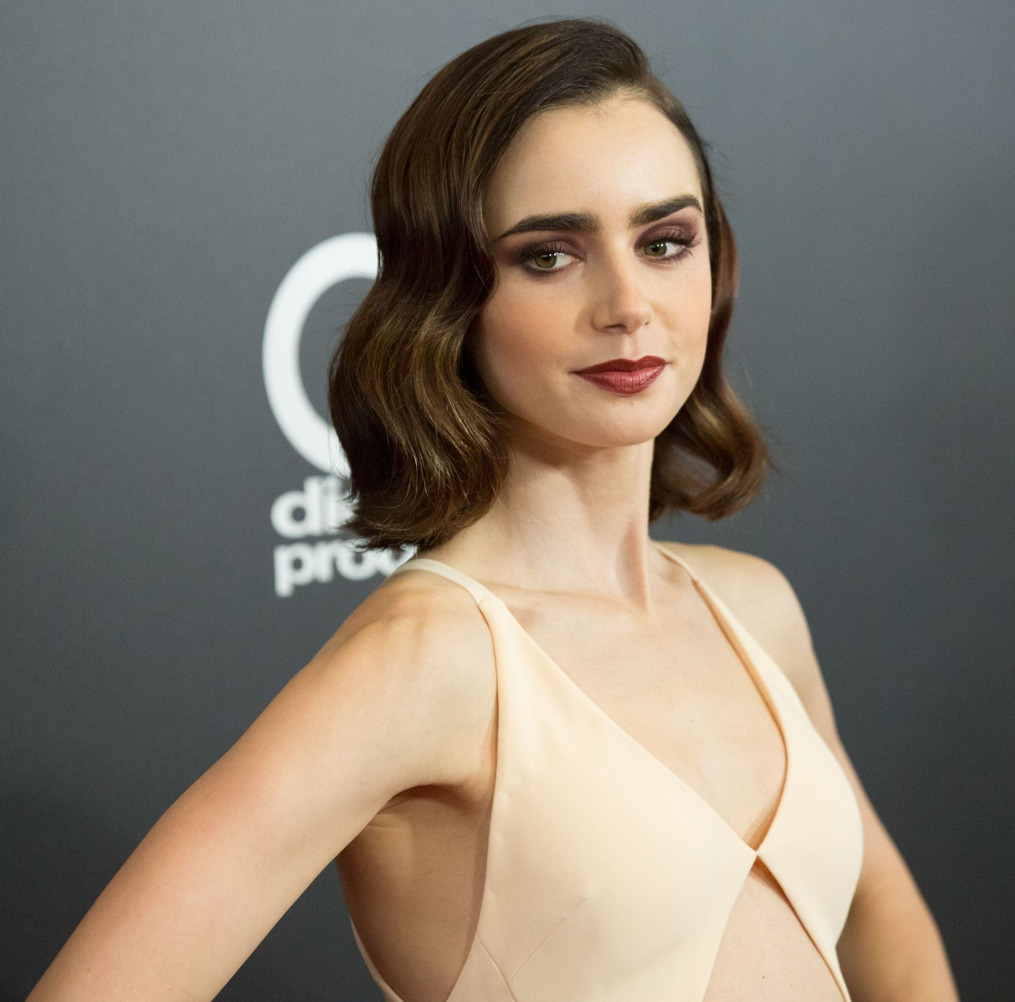 actress lily collins with sideswept wavy hair