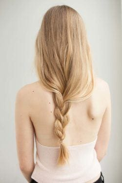 Blonde woman with long loose messy braid