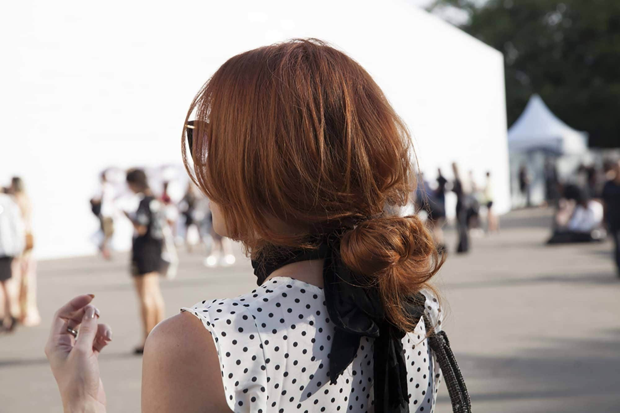 blogger bun: picture of street style model with blogger bun hairstyle
