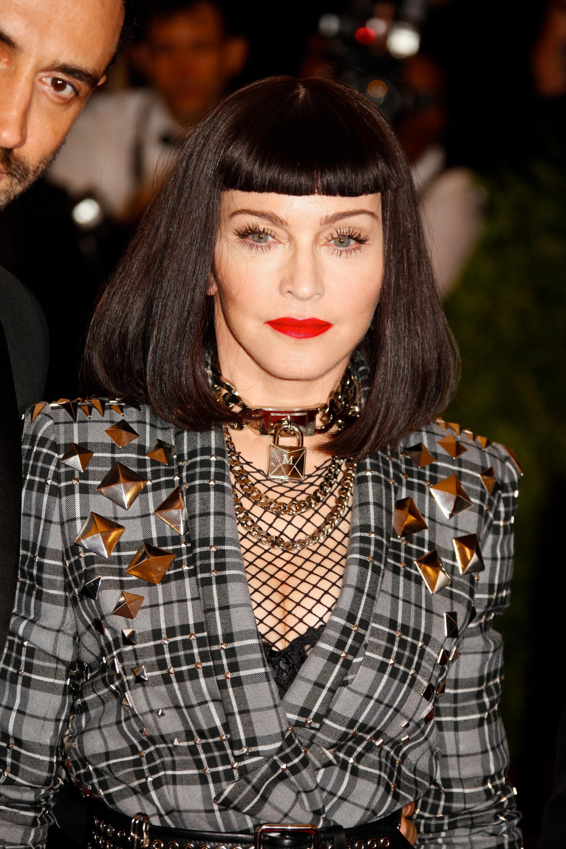Madonna at the 2013 met ball in a dark brunette bob length wig with a blunt short fringe.