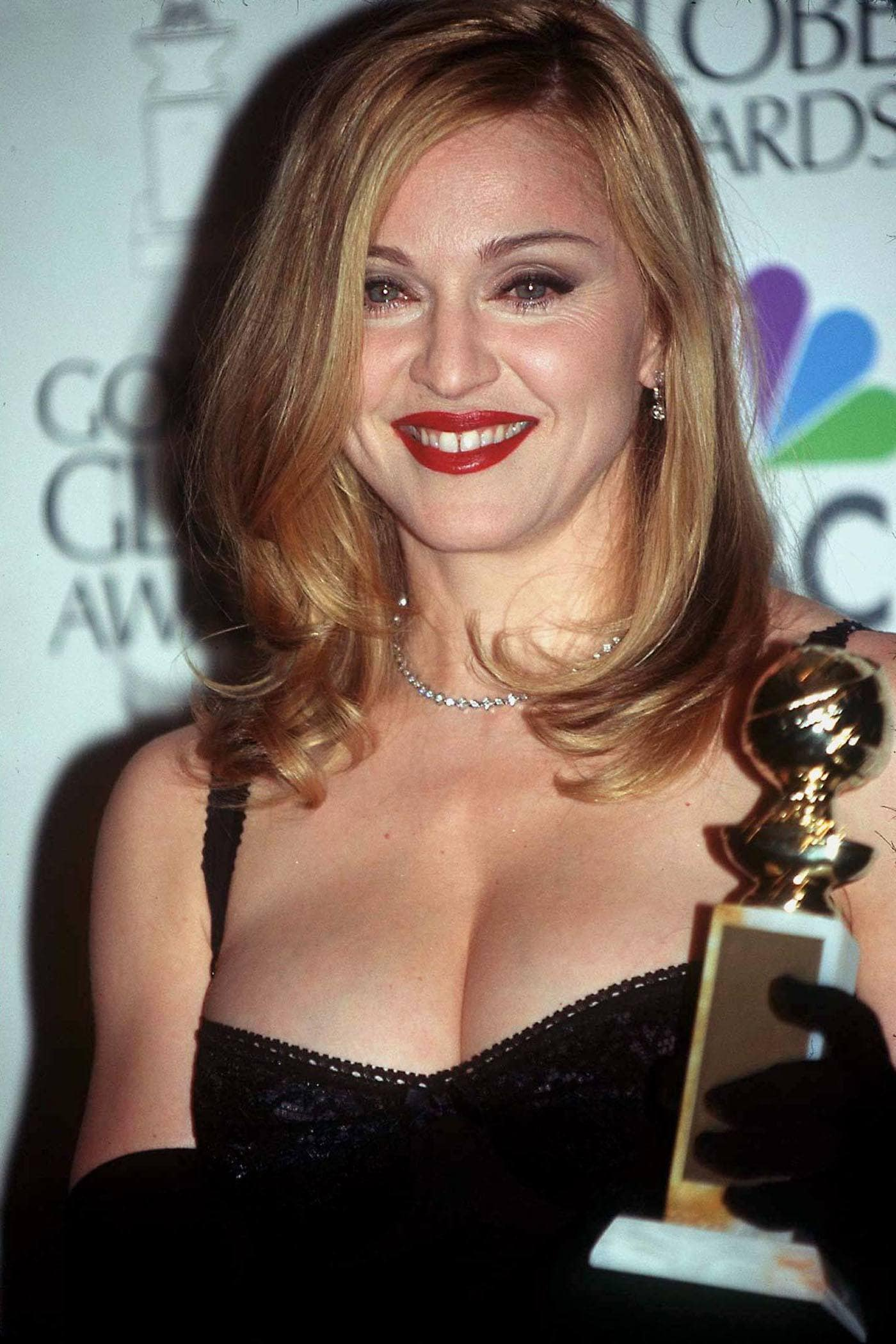 Madonna at the 1997 Golden Globe awards with shoulder length flipped out layered honey brown hair.