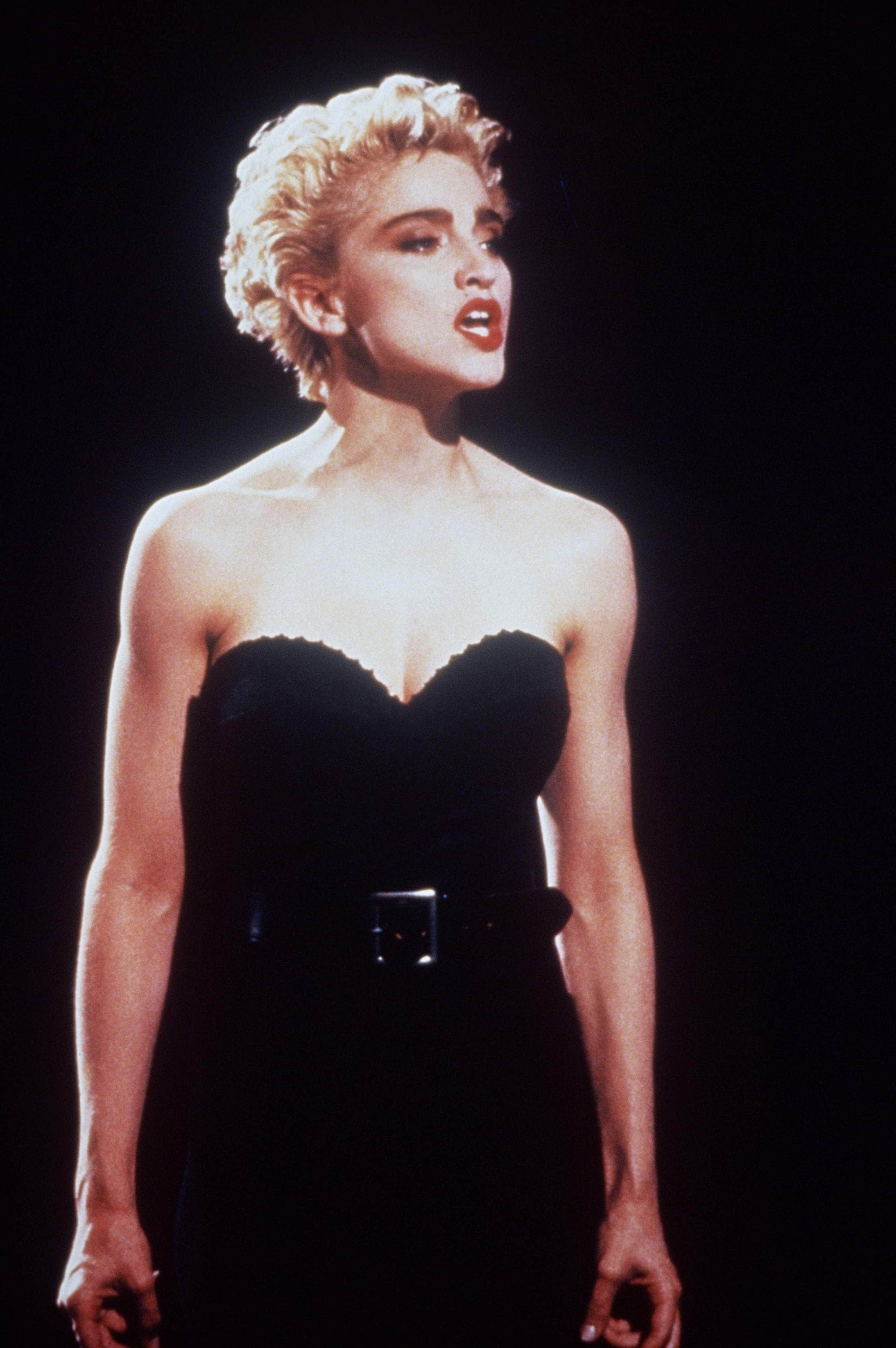 Madonna in 1988 with a Marilyn Monroe inspired blonde curly perm hairstyle.