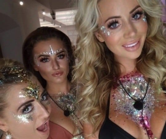 selfie of love island contestants georgia amber and olivia covered in glitter