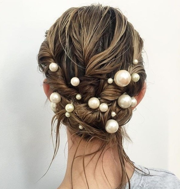 backs shot of a an updo with pearl bobby pins in it