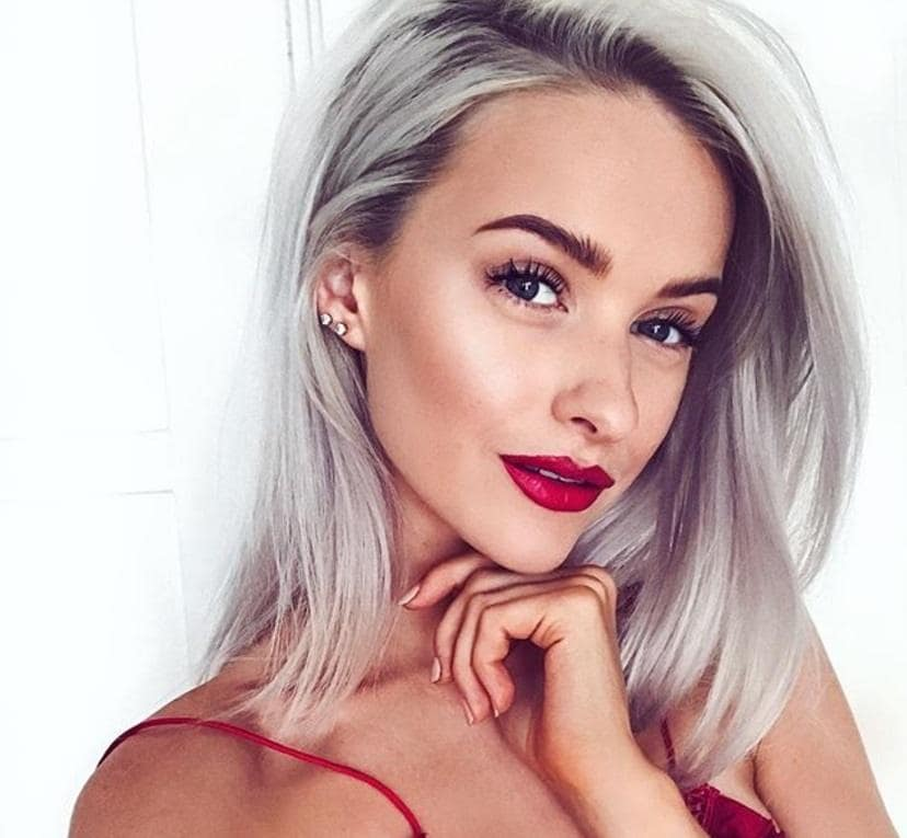 picture of model with medium silver blonde hairstyle with red lipstick
