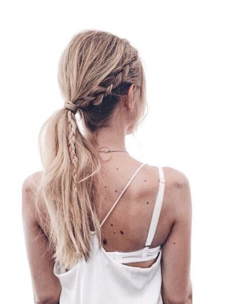 long wavy blond ehair in low ponytail with thick side braid on the right side