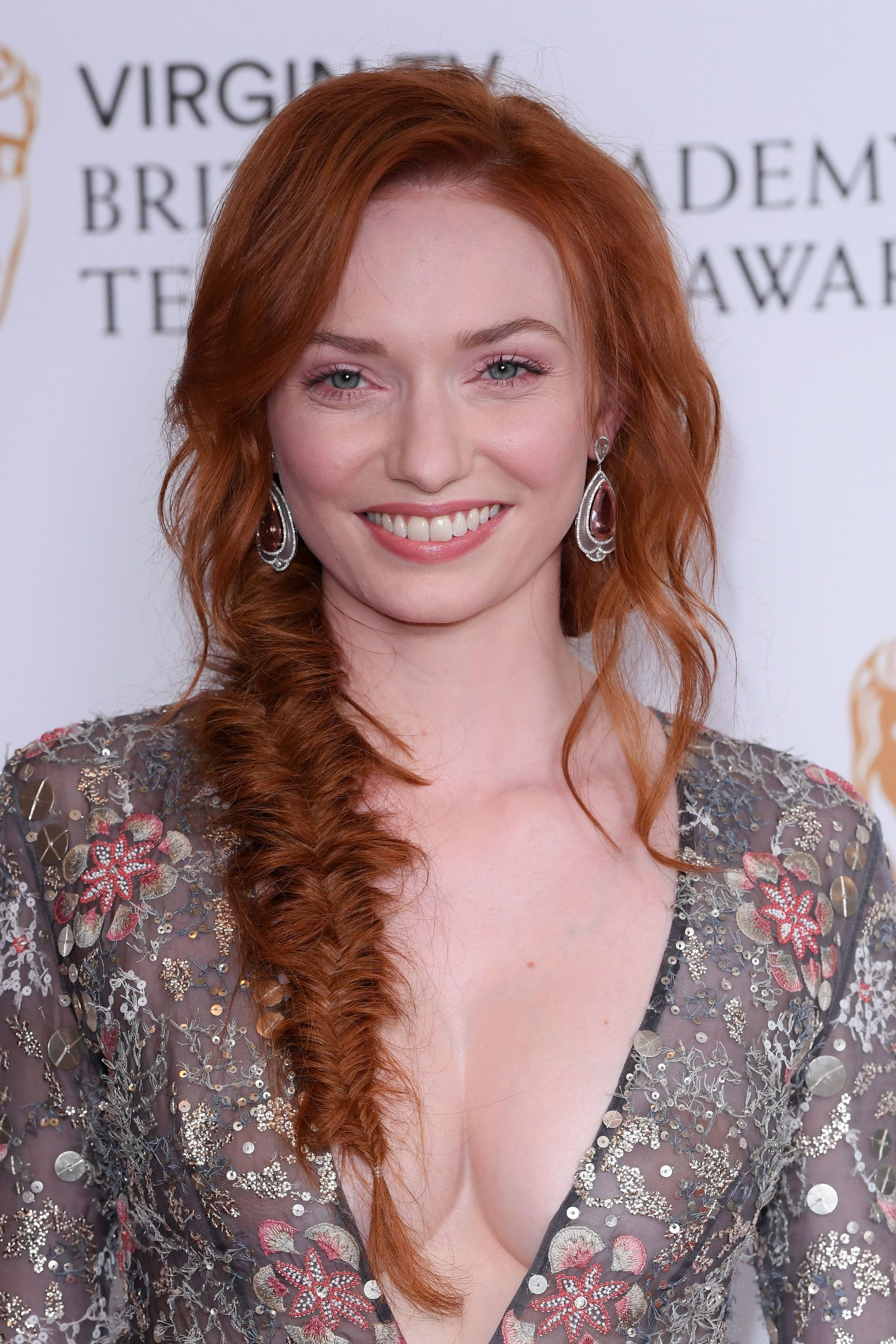 easy braids for long hair: eleanor tomlinson with side fishtail braid on the virgin tv bafta awards red carpet, wearing floral dress