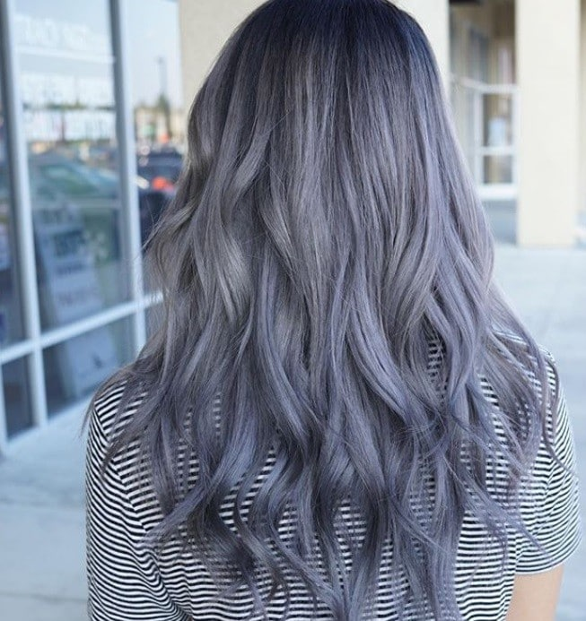 back shot of woman with dark silver hair with lilac highlights in it