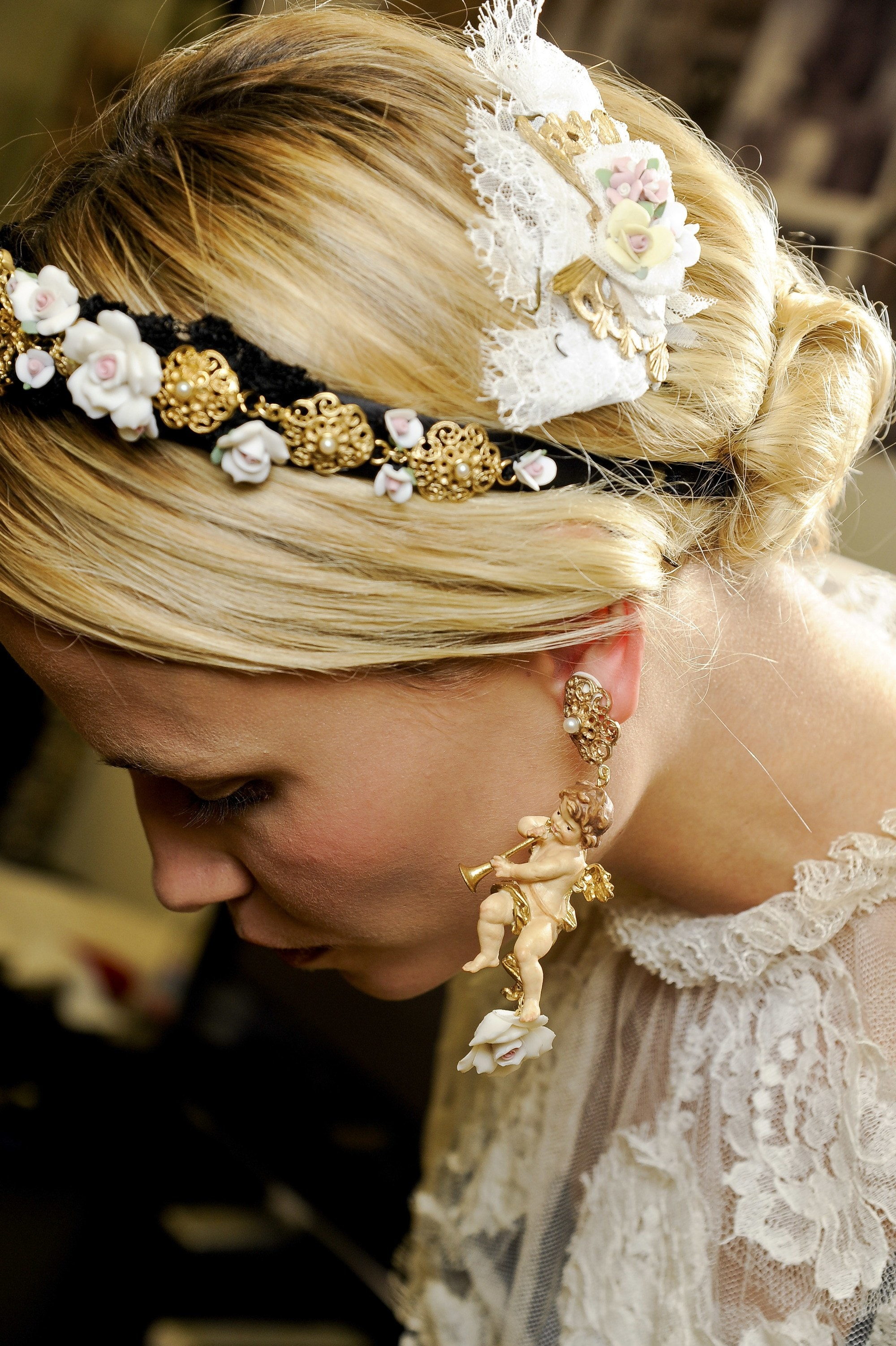 backshot of model with low accessoried hair bun at the dolce gabbana show