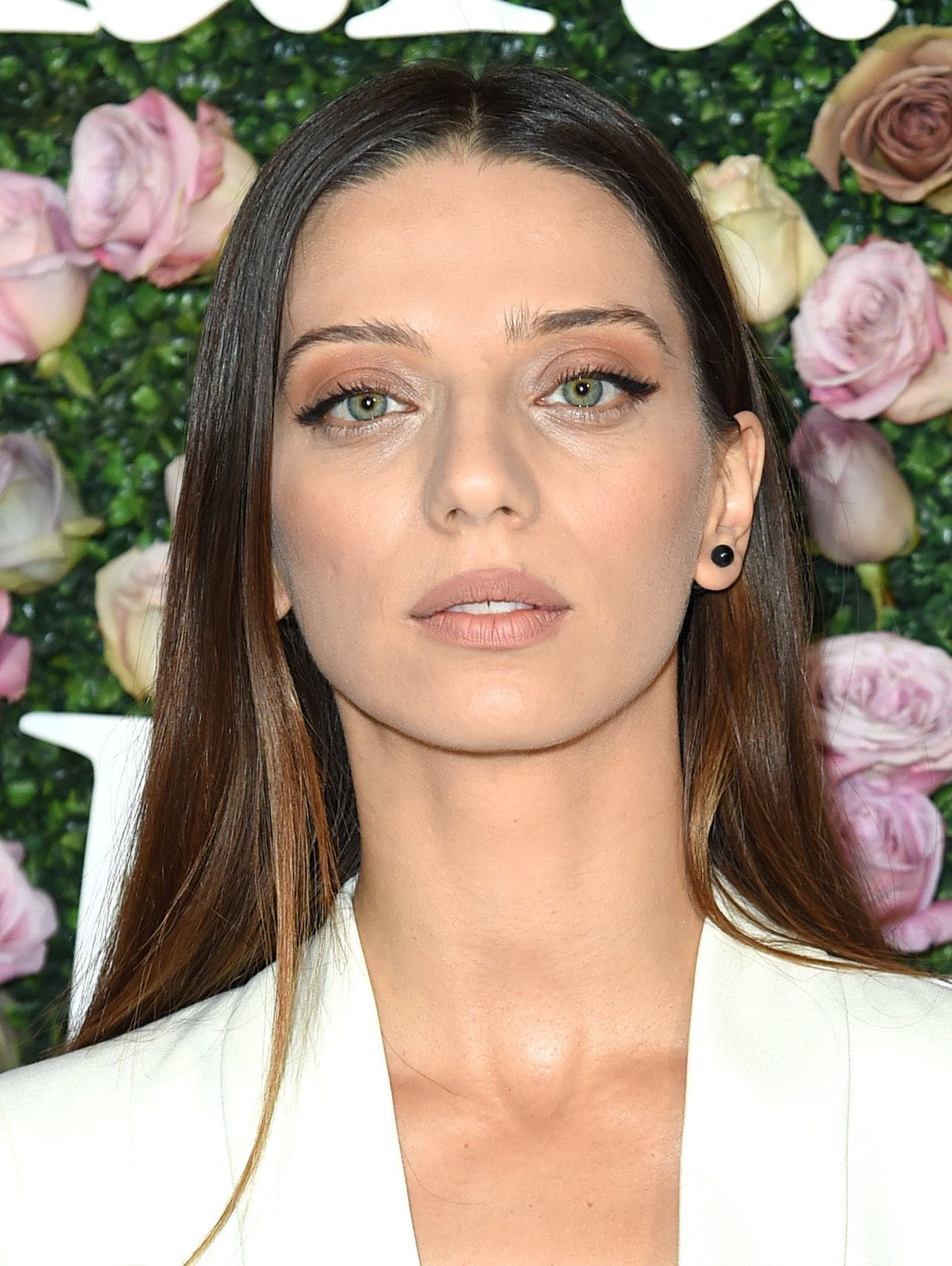 Angela Sarafyan with dark brown hair that has accented with a dark blonde hue on the women in film red carpet