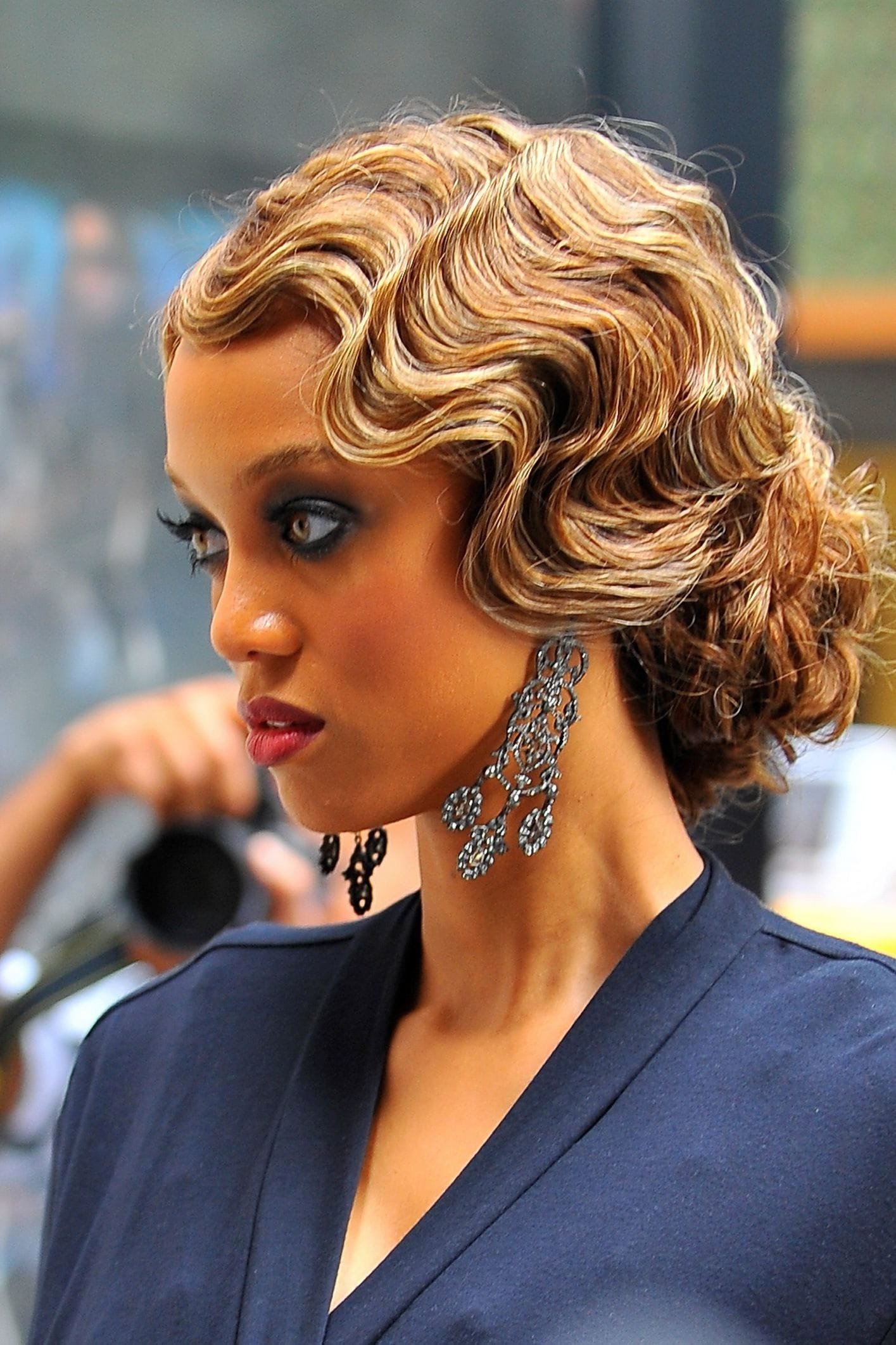 supermodel tyra banks on the set of gossip girl with 1930s finger curls