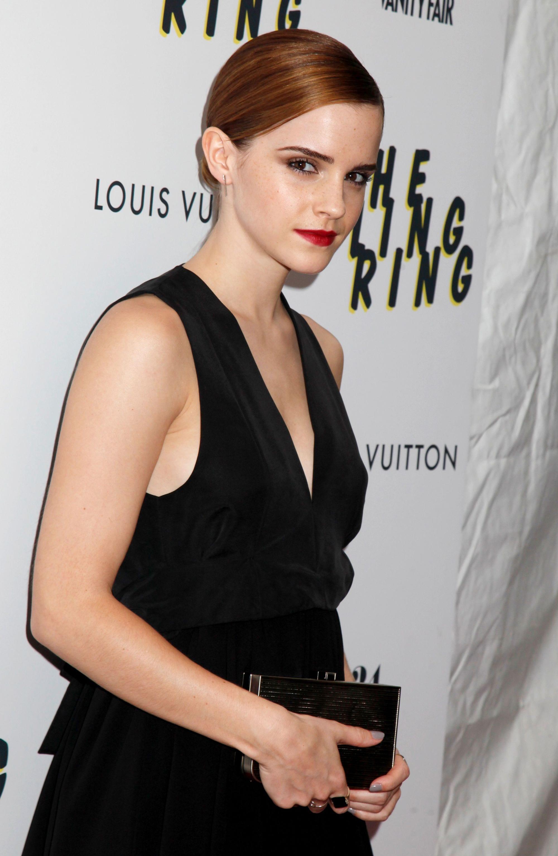 Emma Watson red auburn hair slicked back low bun