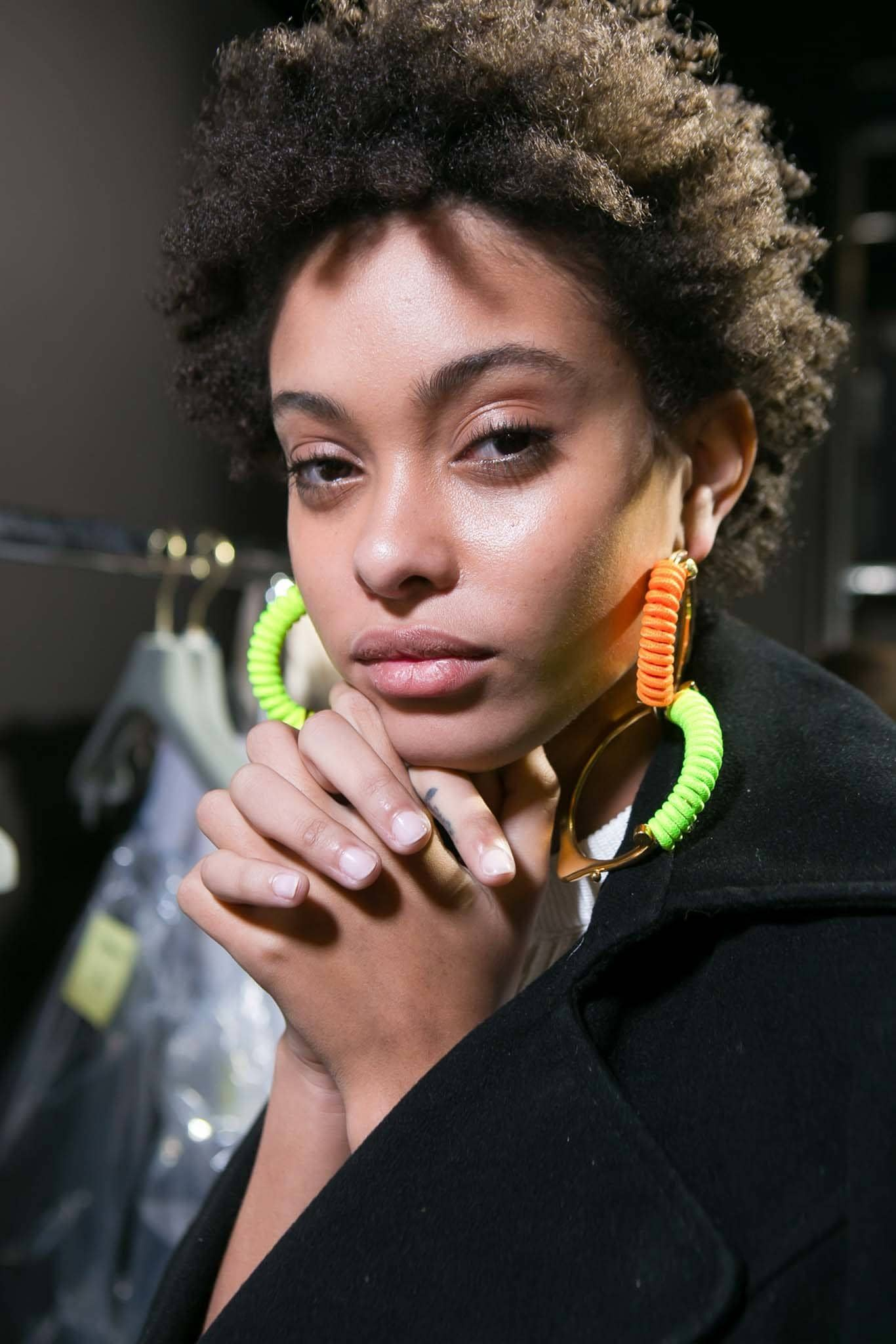 backstage shot of model with natural textured hair posing