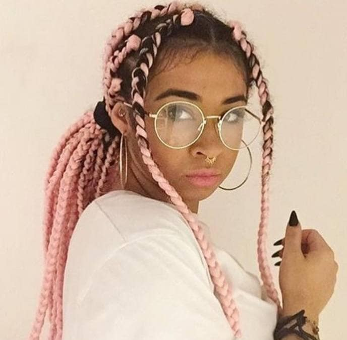 box braids ponytail: woman with pink box braids hairstyle styled into a ponytail