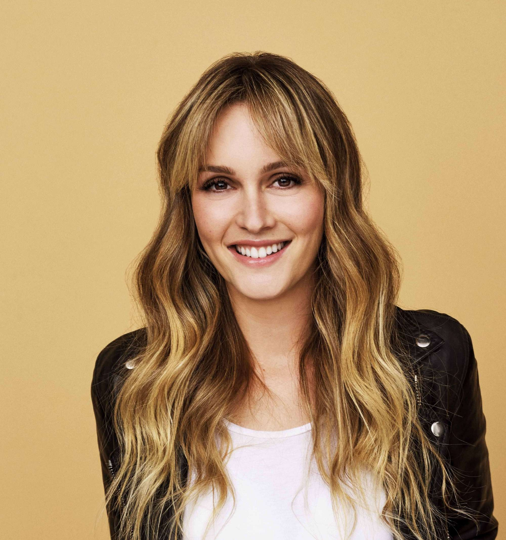 hihglighted blonde hair of a smiling woman