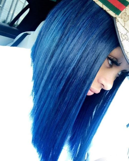 Side view of Blac Chyna asymmetrical blue bob with cap