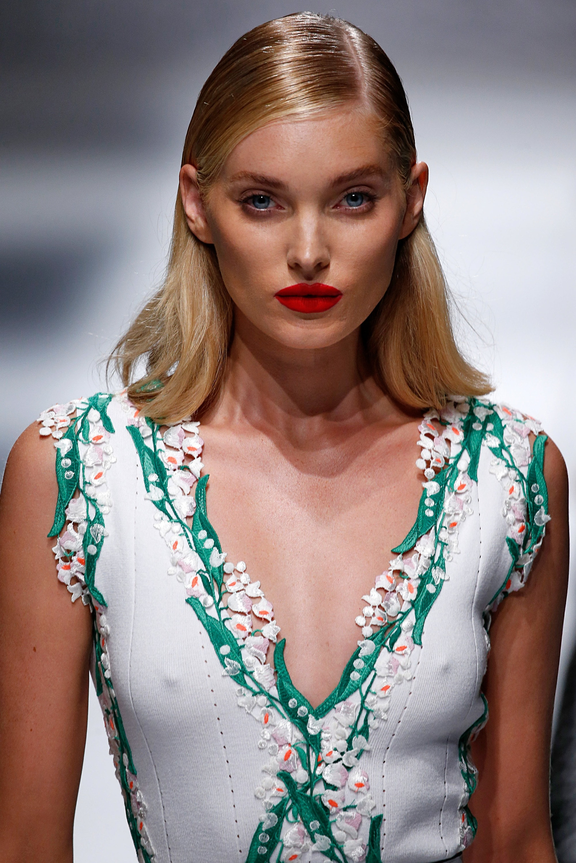 shot of model on the blumarine runway with sleek deep side part hairstyle