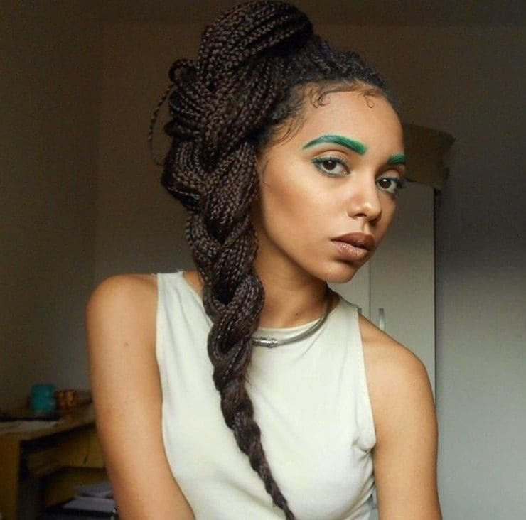 close up shot of woman with braided box braids ponytail hairstyle