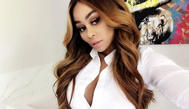 Blac Chyna with long golden brown hair with loose curls
