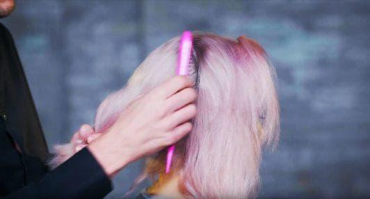 Superdrug Loves cartoon kid Halloween hair tutorial side view of hair being sectioned