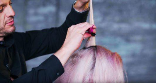 Superdrug Loves cartoon kid Halloween hair tutorial side view of hair being back brushed
