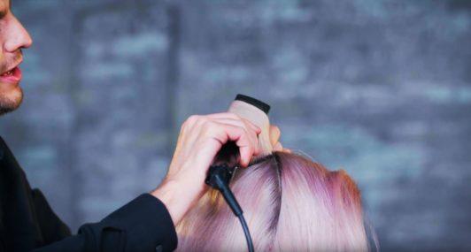 Superdrug Loves cartoon kid Halloween hair tutorial side view of hair being curled with straightener