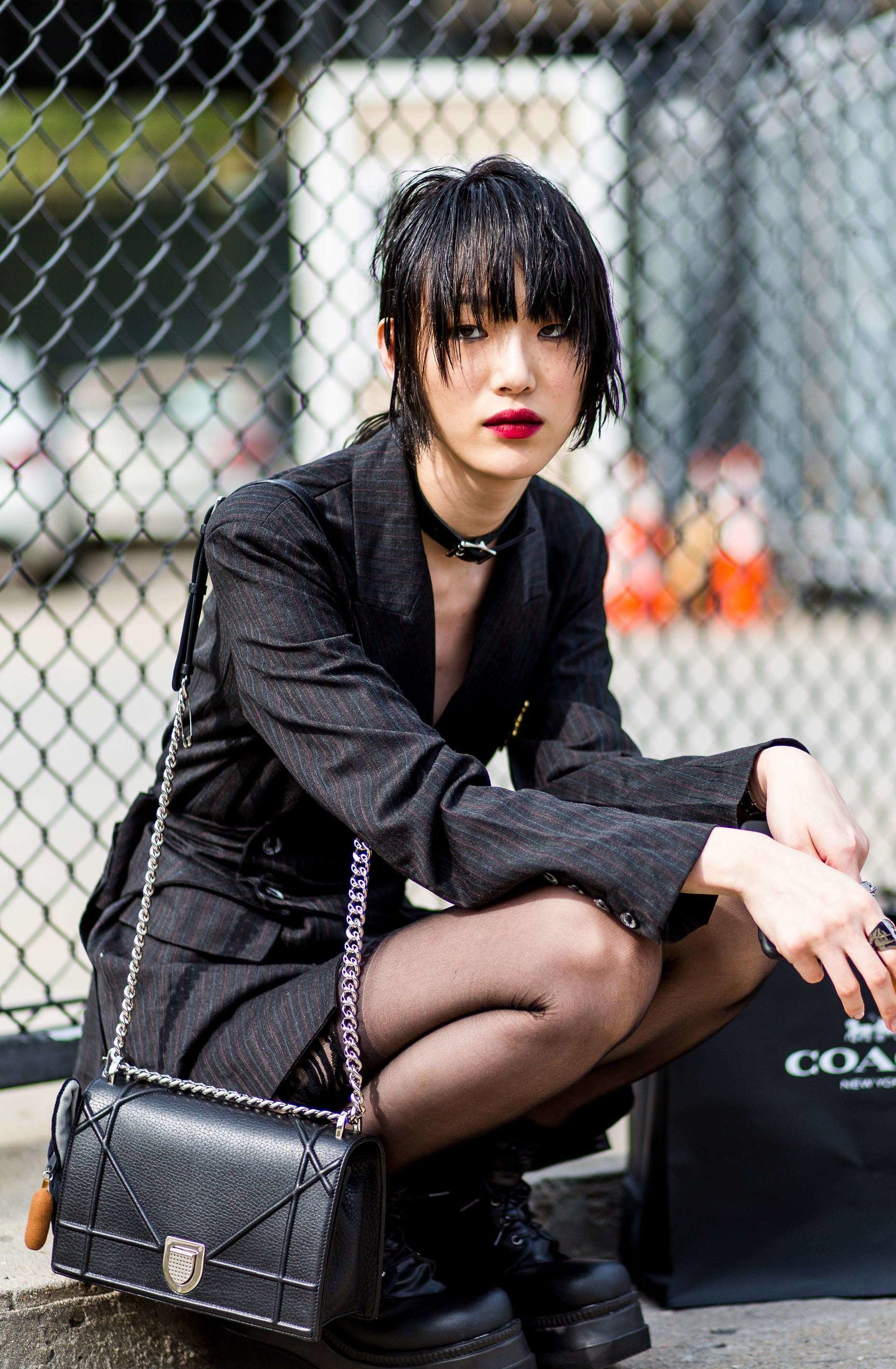 short asian hairstyles: woman with choppy shag hairstyle on the street