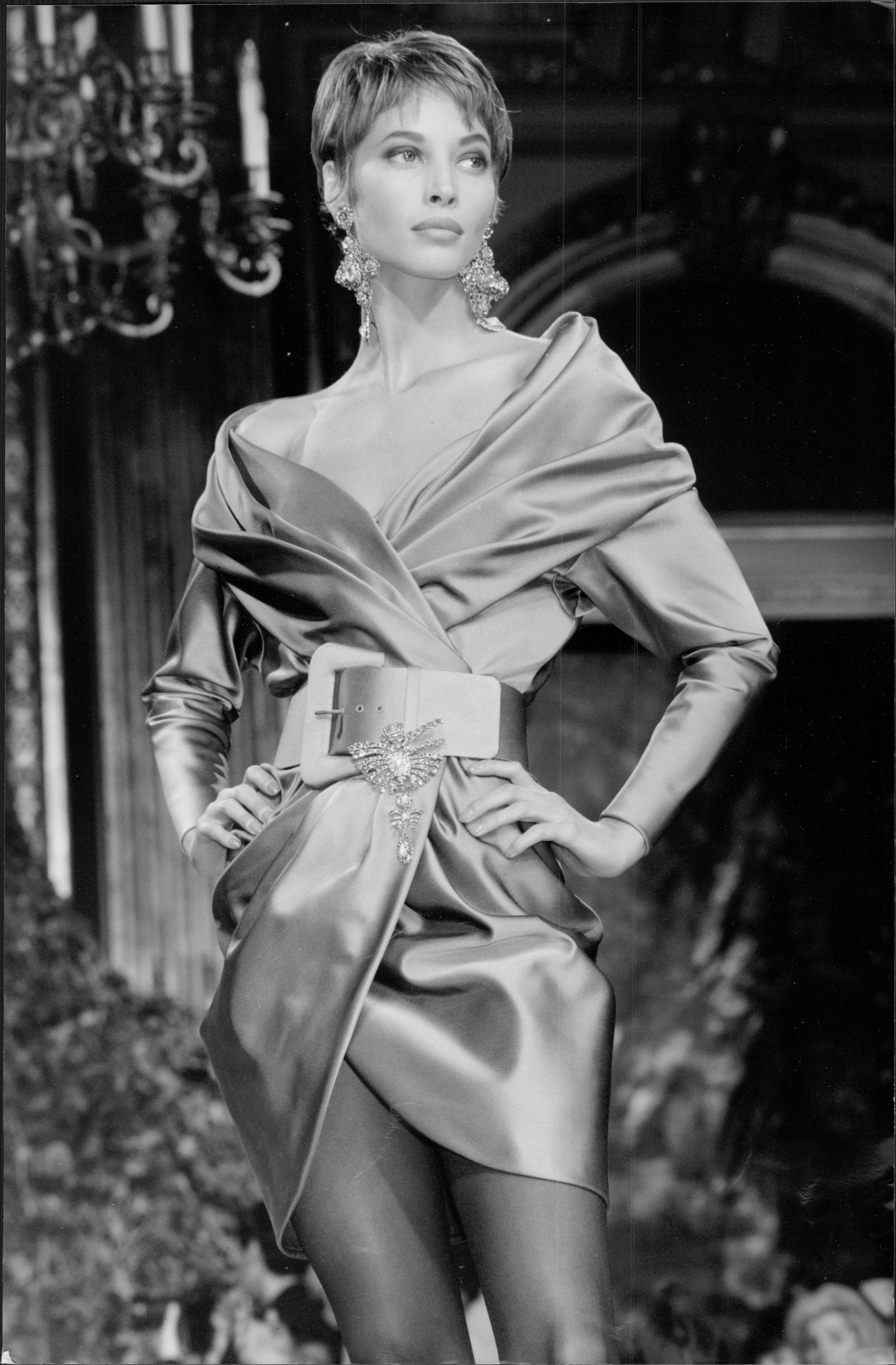 shot of christy turlington with short pixie cut on the runway wearing a pixie cut