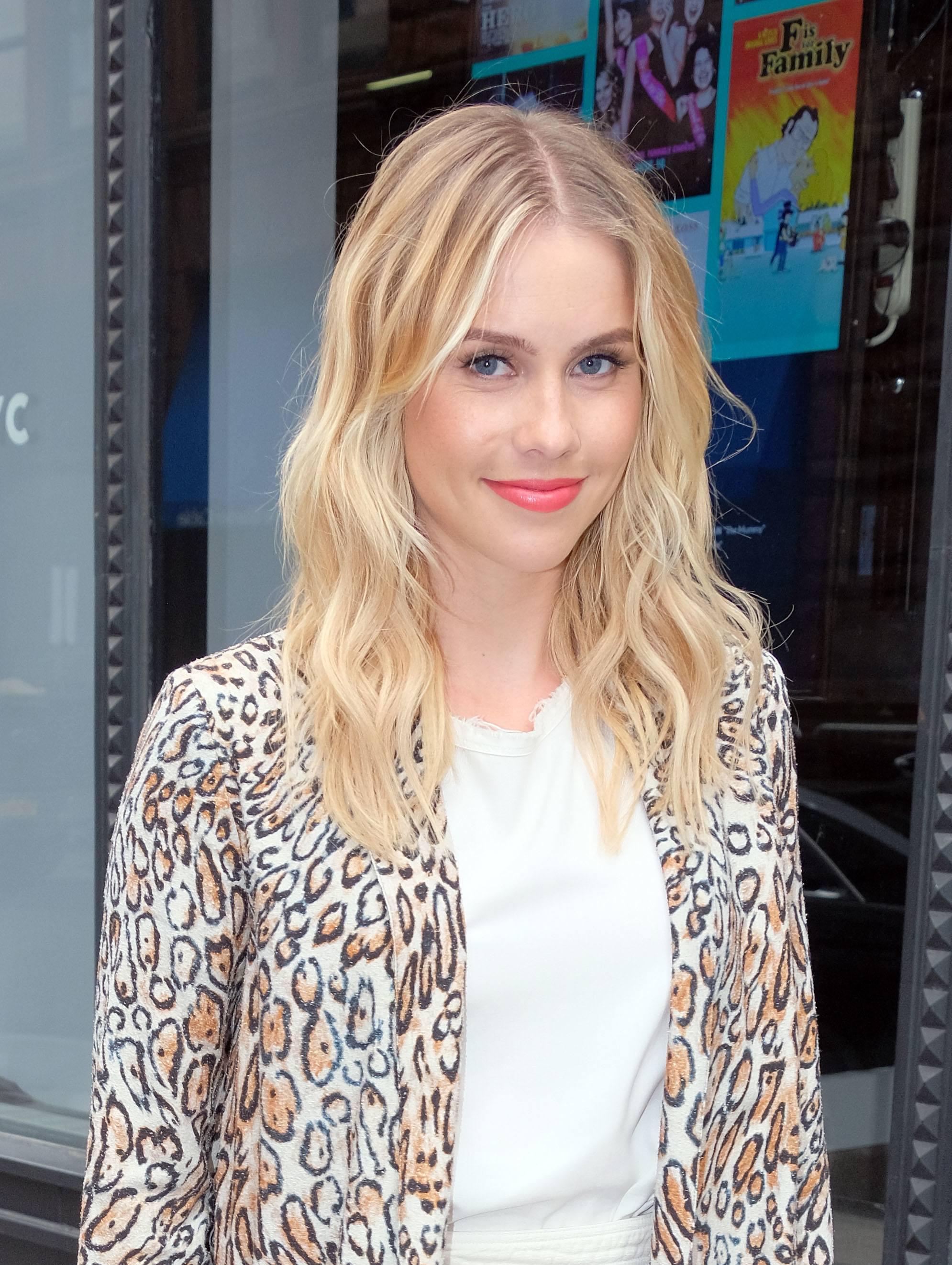 actress claire holt with medium length wavy cream soda blonde hair