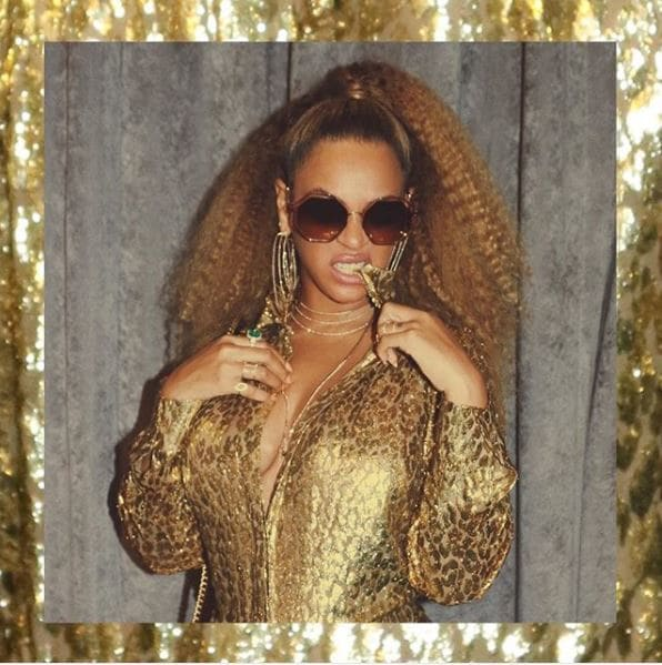 front view of beyonce with blonde hair in crimped style high ponytail
