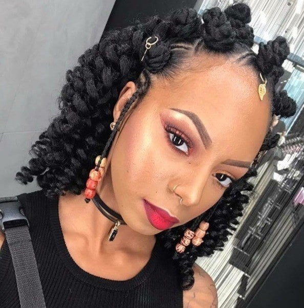 bantu knots on weave: shot of woman with crochet weave styled into half up bantu knots style