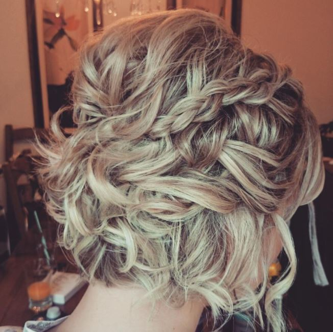 Easy braids for short hair: Side view of short curly blonde hair pinned back braids