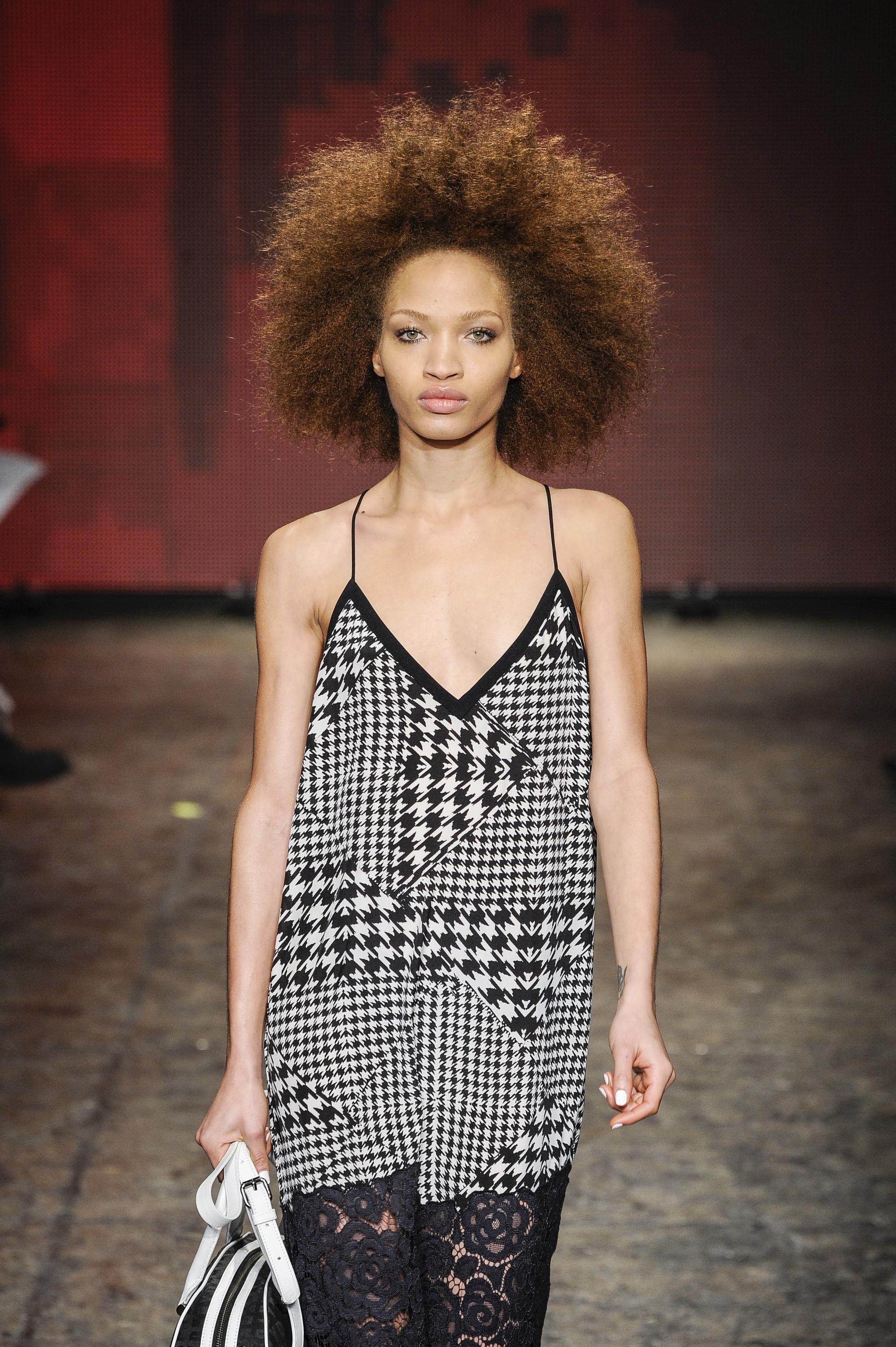 model on runway with black large afro hairstyle