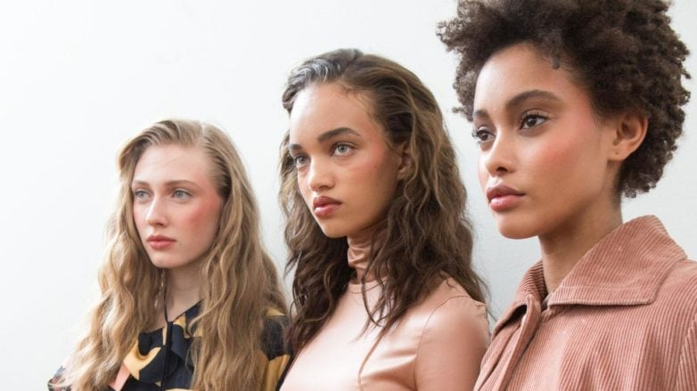 The lazy girl's guide to finding the best leave-in conditioner for dry hair: shot of three models backstage with three different hair types