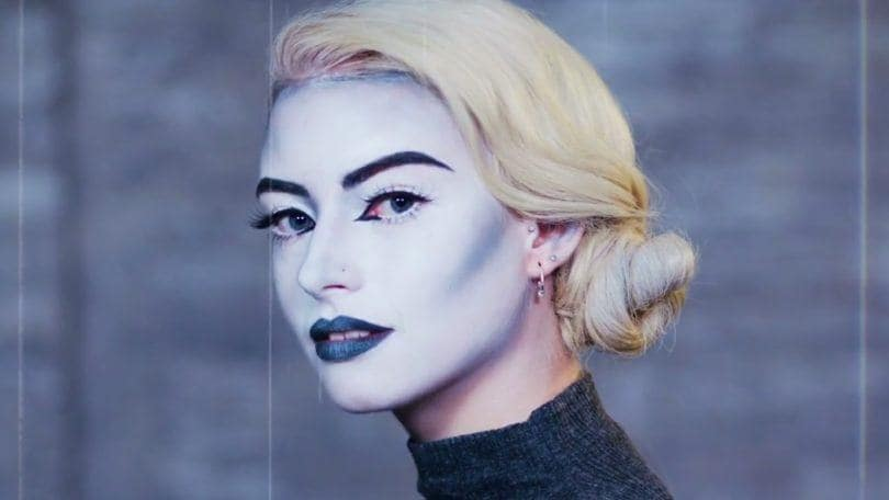 Shot of model with vintage scream queen halloween look with a wavy side chignon hairstyle